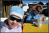 Tourists enjoying sunny afternoon at a Livigno cafe, Italy, Europe