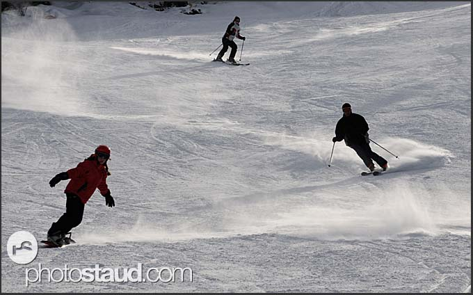 Three skiers on the slopes of St Caterina, Italy, Europe