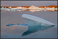 Icebergs floating in the glacial lagoon at sunset, Jokulsarlon, Breidamerkurjokull, Iceland