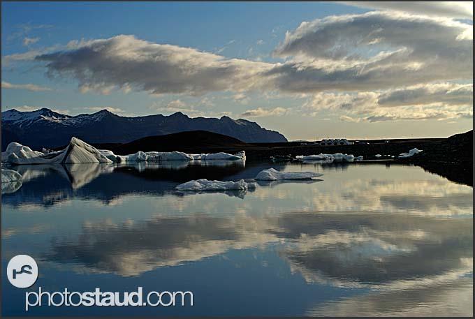 Icelandic landscape reflecting in the glacial lagoon, Jokulsarlon, Iceland