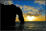 Durdle Door natural limestone arch at sunset, Jurassic Coast World Heritage site, Dorset, England, Europe