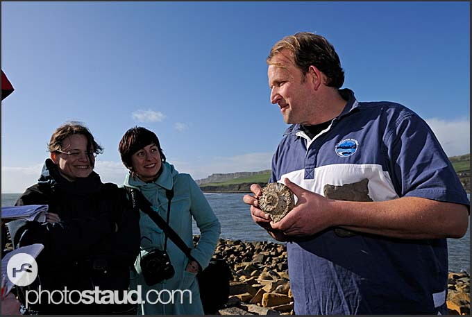 Tourist guide gives explanations on fossil hunting near Kimmeridge, Jurassic Coast World Heritage site, Dorset, England, Europe