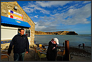 Tourists at Beach cafe near Lulworth Cove, Jurassic Coast World Heritage site, Dorset, England, Europe