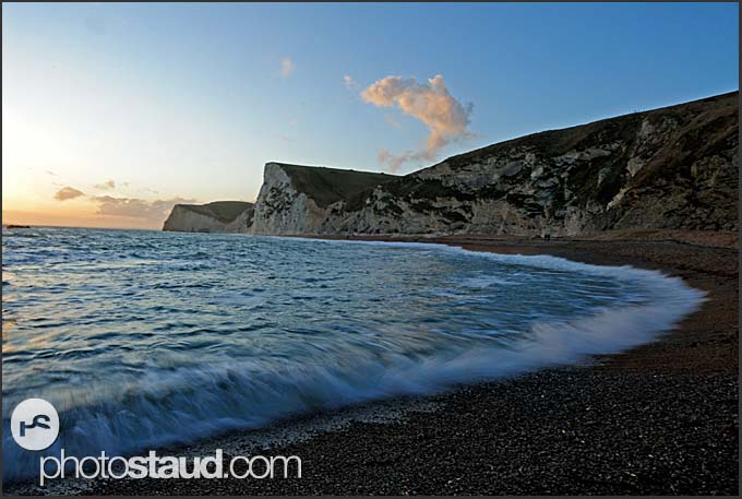Surf on the Jurassic Coast at twilight, World Heritage site, Dorset, England, Europe