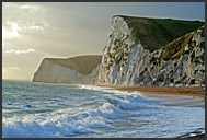 Surf and chalk cliffs on the Jurassic Coast at twilight, World Heritage site, Dorset, England, Europe