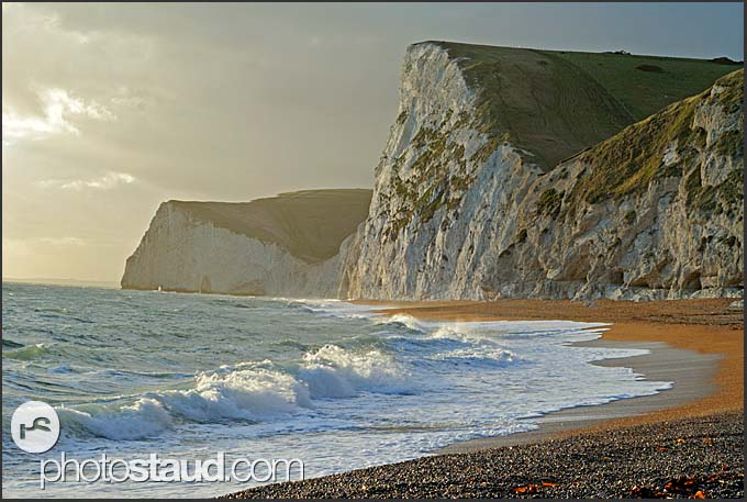 Surf and chalk cliffs on the Jurassic Coast at twilight, World Heritage site, Dorset, England, Europe