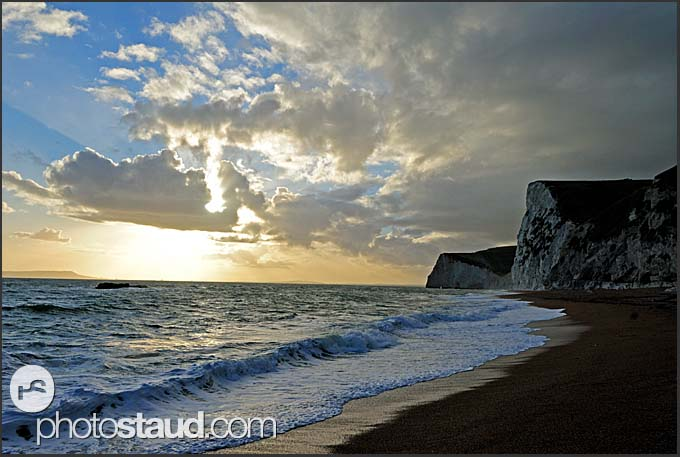 Surf, clouds and chalk cliffs on the Jurassic Coast at twilight, World Heritage site, Dorset, England, Europe