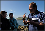 Tourist guide gives explanations on fossil hunting near Kimmeridge, Jurassic Coast World Heritage site, Dorset, England, Europe