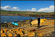 Surfers near Kimmeridge, Jurassic Coast World Heritage site, Dorset, England, Europe