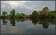 Landscape of Kafue National Park reflecting in Lunga River, Zambia