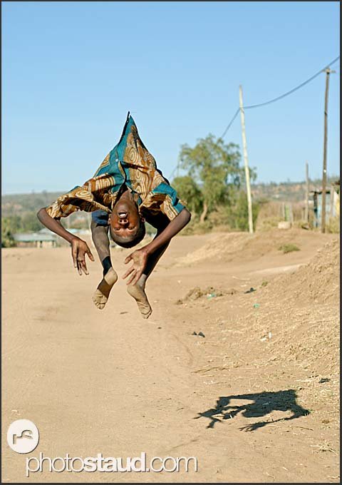 Thirteen-year-old Christopher practices his martial art skills in the dusty roads of Maralal, Northern Kenya