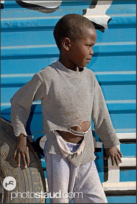 Young Kenyan boy in worn-out pull-over, Maralal, Northern Kenya