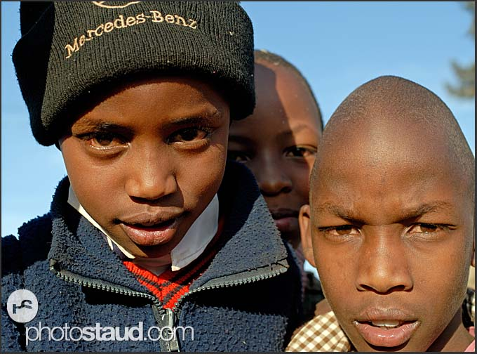 Kenyan boys with Mercedes Benz hat in Nyahururu, Kenya