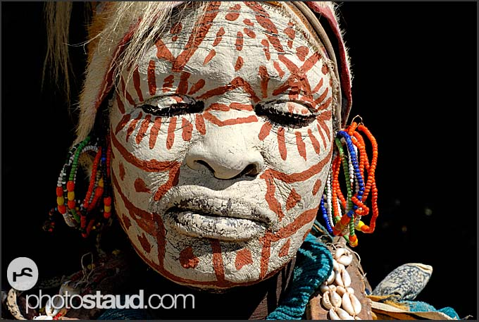 Portrait of kikuyu tribeswoman with traditionally painted face and