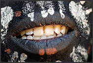 Detail of lips - dark-painted Kikuyu tribesman, Kenya