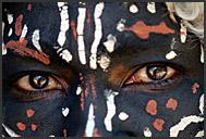 Close up portrait of dark-painted Kikuyu tribesman, Kenya