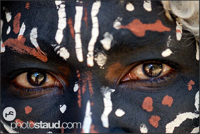 Close up portrait of dark-painted Kikuyu dancer, Kenya