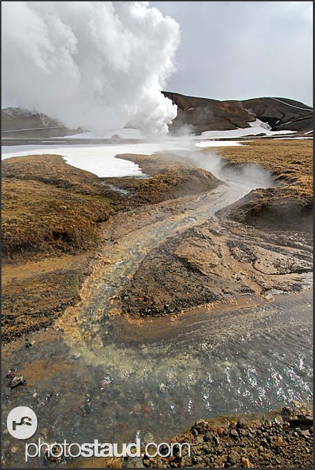 Small stream with hot water from the geothermal power plant near the volcano Krafla, Iceland