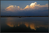 Stormy clouds reflecting in the Luangwa river, South Luangwa National Park, Zambia