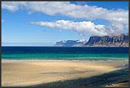 Sea, beaches, cliffs and clouds in the landscape of Westfjords, Iceland