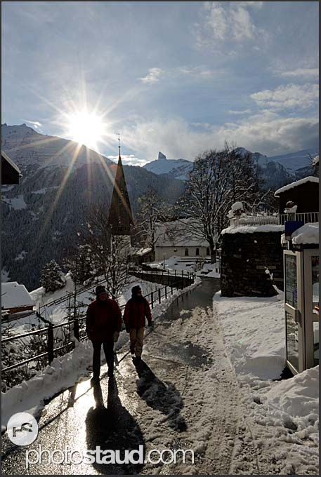 Tourists in Wengen at sunset, Switzerland, Europe