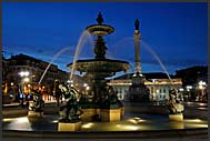 Illuminated fountain at Rossio Square at night, Baixa District, Lisbon, Portugal