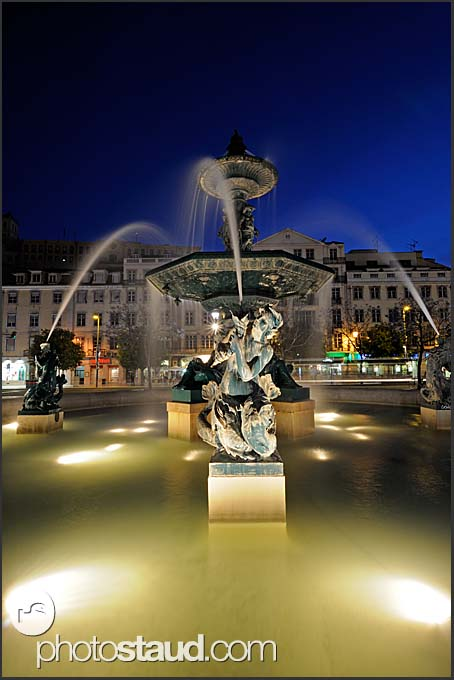 Fountain at Rossio Square illuminated by night, Baixa District, Lisbon, Portugal