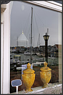 Marken harbor reflecting in window, The Netherlands, Europe
