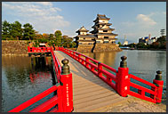 Red wooden Uzumi-Bashi bridge leading to Matsumoto castle, National Treasure, Matsumoto, Japan