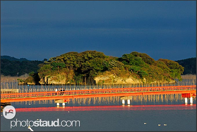 Red bridge spanning across tiny islands of Matsushima bay, Japan