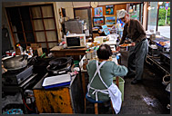 Elderly Japanese couple in selling seafood, Matsushima bay, Japan