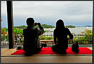 Two Japanese enjoying view of Matsushima bay from Kanrantei teahouse, Japan