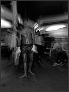 Muay Thai box fighter waiting for his turn inside Lumpini Boxing Stadium, Bangkok, Thailand