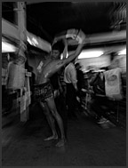 Muay Thai box fighter stretching out before a fight, Lumpini Boxing Stadium, Bangkok, Thailand