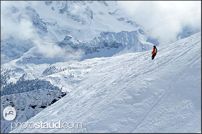 Freerider in the winter landscape of Swiss Alps, Murren Schilthorn, Switzerland, Europe