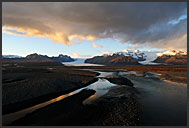 Myrdalsjokul glacier reflecting in pond, Iceland