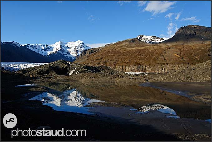 Myrdalsjokul glacier reflecting in pond, Iceland