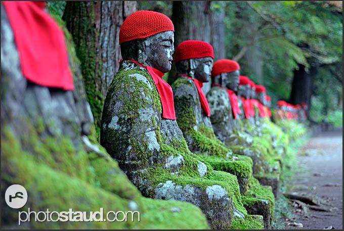 Row of red-bibbed Jizo bodhisattva statues in Nikko National Park, Narabi-jizo, Bake-jizo, Japan