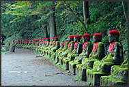One of Narabi-jizo statues covered in moss, Nikko National Park, Japan