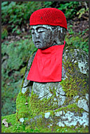 Line of red-bibbed Jizo bodhisattva statues in Nikko National Park, Narabi-jizo, Bake-jizo, Japan