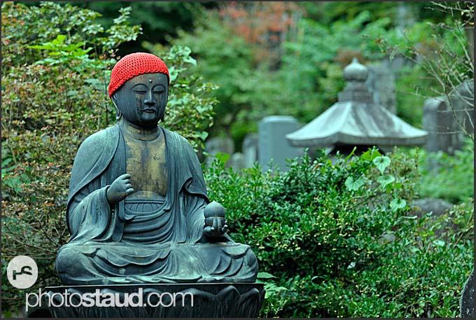 Jizo statue sitting in a Nikko shrine, Nikko National Park, Japan