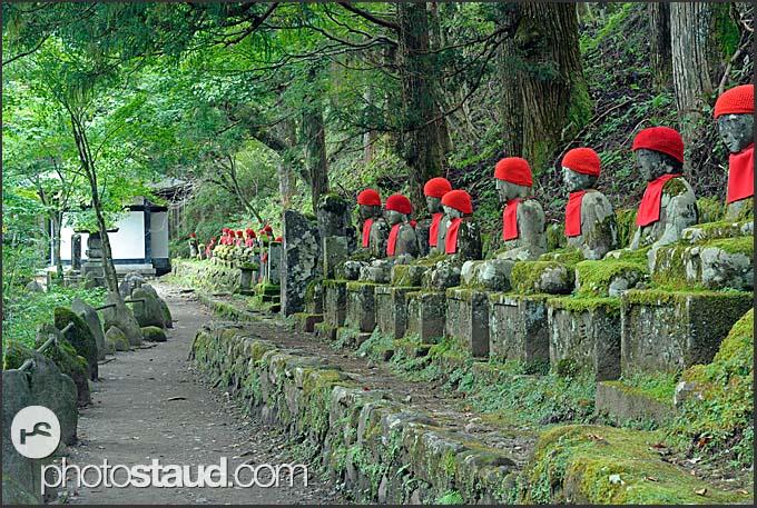 Procession of red-bibbed Jizo bodhisattva statues in Nikko National Park, Japan