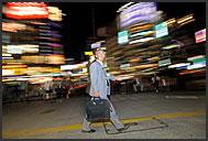 Japanese salaryman, businessman, walking on street at night, Sendai, Japan