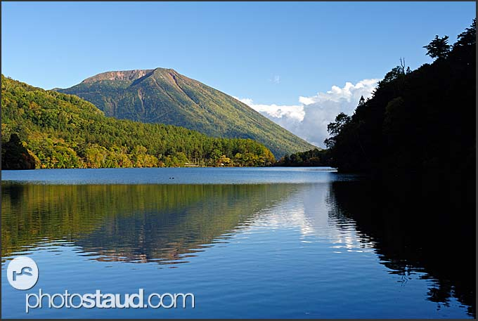 Autumnal landscape reflects in Lake Yunoko, Nikko National Park, Japan
