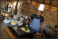 Chef preparing omelet in Pafuri Camp, Wilderness Safaris, Kruger Park, South Africa