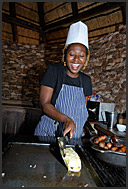Chef serving omelet in Pafuri Camp, Wilderness Safaris, Kruger Park, South Africa