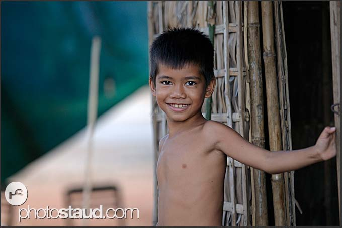 Cambodian boy in front of his cottage, Siem Reap, Cambodia