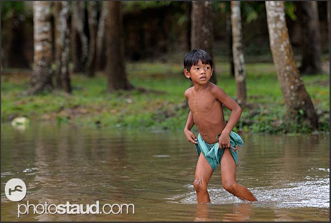 Little boy knee-deep in water, Cambodia