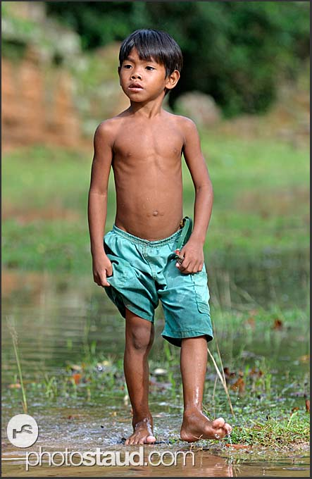 Bare-footed boy in water, Cambodia