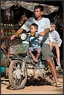 Cambodian boy bathing in Siem Reap river, Cambodia